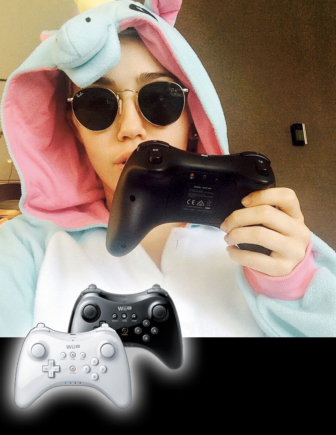 Miley Cyrus holding a Wii U Controller